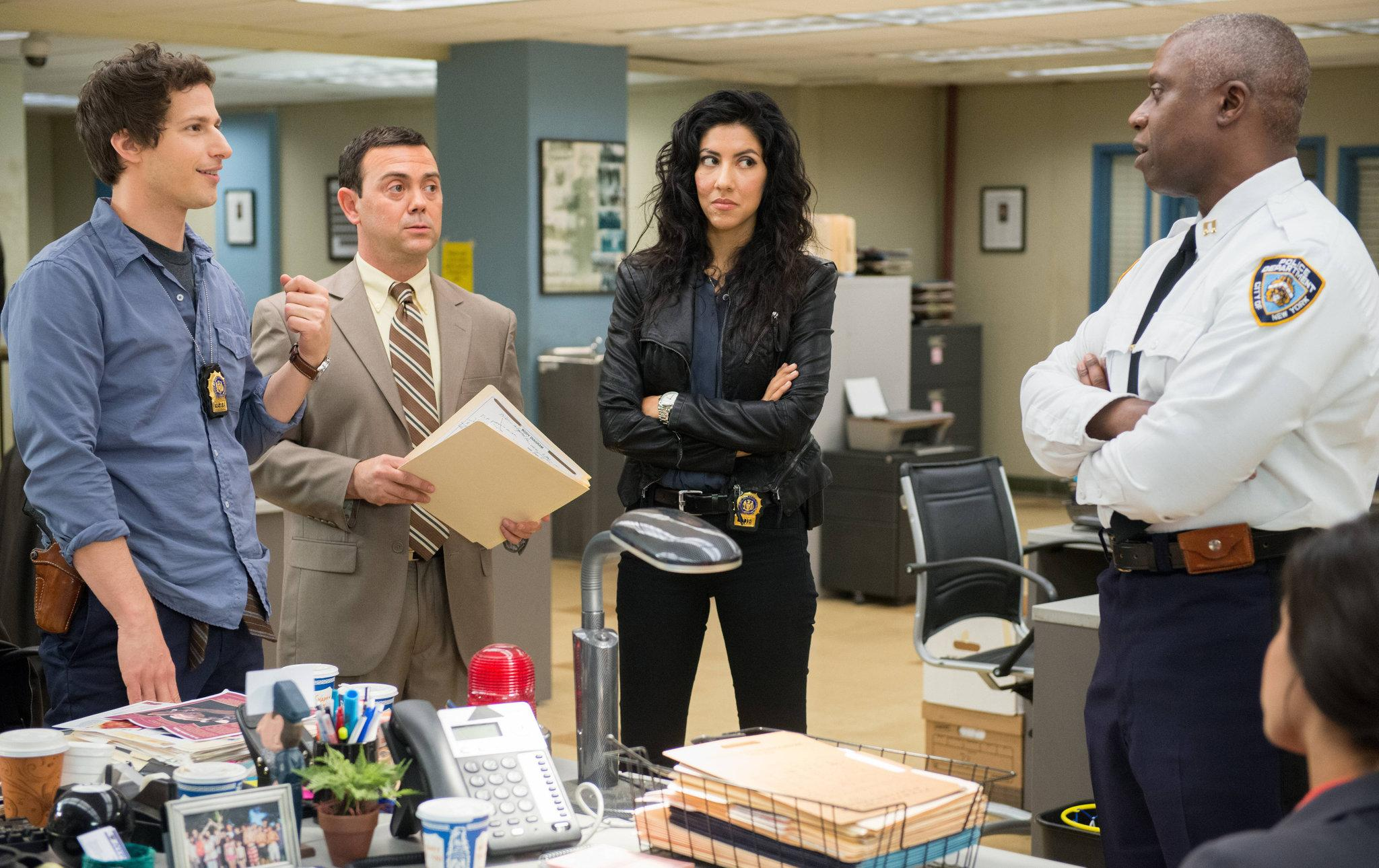 The usual workday scene in Precinct 99: Detective Jake Peralta (Andy Samberg) being his goofy persona with his co-workers, Detective Charles Boyle (Joe Lo Truglio) and Detective Rosa Diaz (Stephanie Beatriz).  Rosa Diaz (Stephanie Beatriz).  Detective Rosa Davis (Stephanie Beatriz) and Detective Charles Boyle (Joe Lo Truglio).